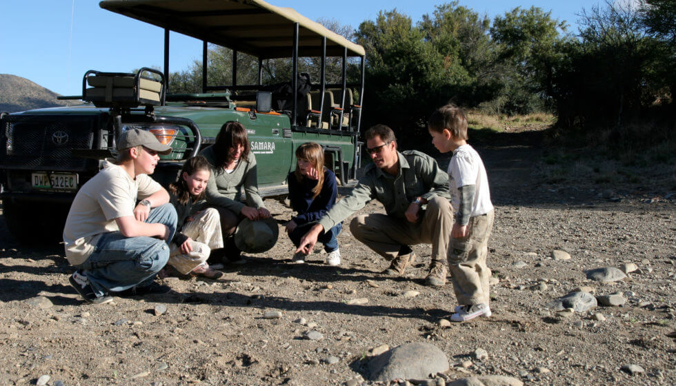 Teaching kids about tracking at Samara Private Game Reserve, Great Karoo, South Africa