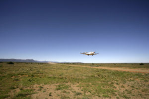 Plane taking off from gravel airstrip, Samara Private Game Reserve, Great Karoo, South Africa