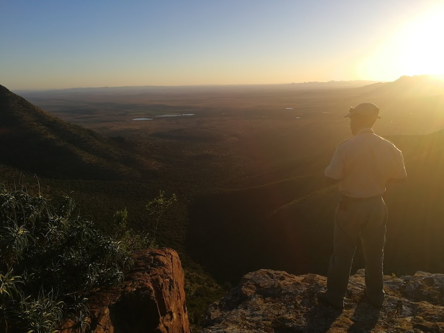 Julius looks out over the Plains of Camdeboo, Samara Private Game Reserve, Great Karoo, South Africa